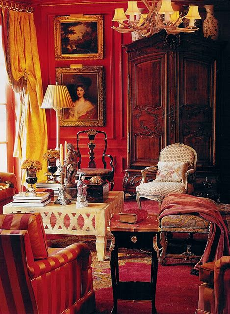 I love a red room! Adore the french armoire as well, the contemporary coffee table keeps it young and current. love.