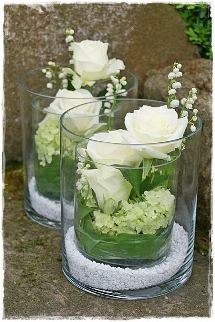 Doubled cylinder glass vases - floral foam, lily of the valley leaves, roses, snowball, maiglöckchen - smell delicious -.Station 88 **