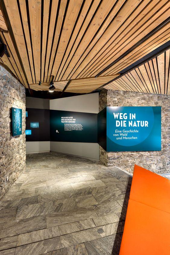 holzer kobler exhibition design teal, orange, and wood
