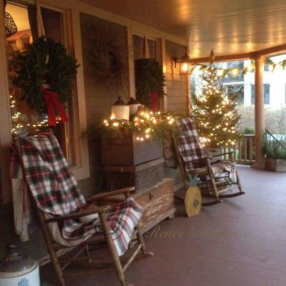 Beautifully decorated Christmas porch.: