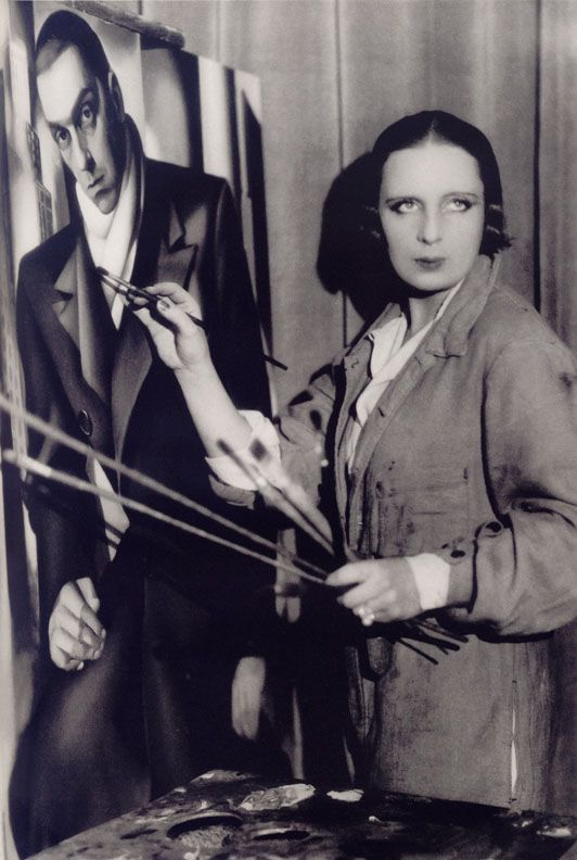 Tamara de Lempicka in front of the portrait of her husband Tadeusz (1928) - by Thérèse Bonney she likes that look: