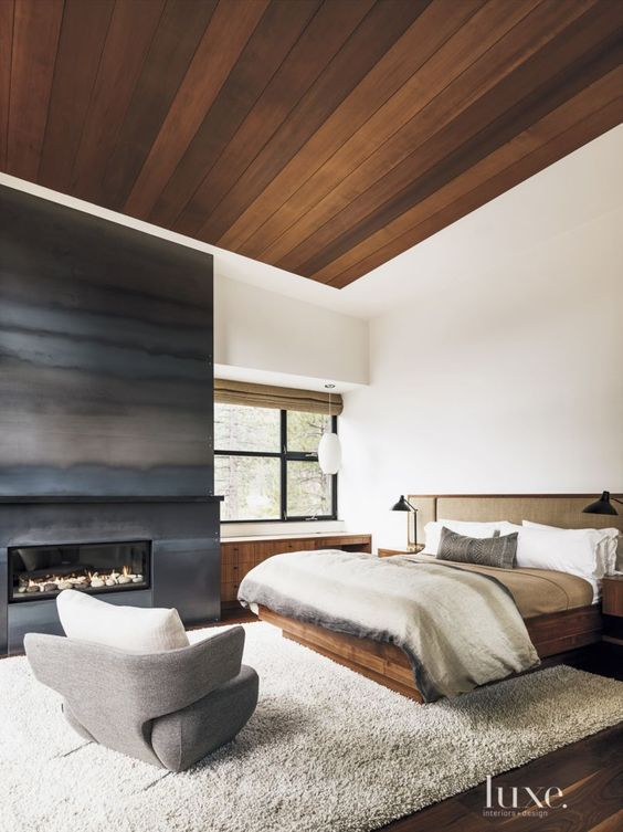 Masculine Master Bedroom With Wood Ceiling And Sleek Fireplace Blissful Bedrooms Pinterest