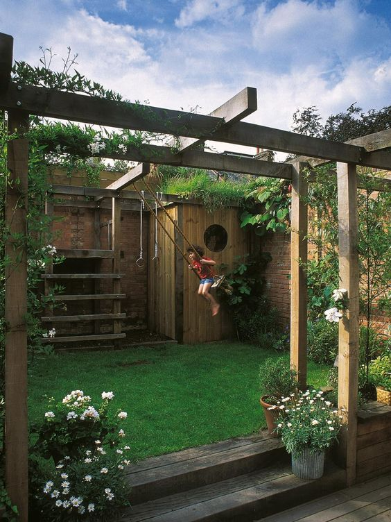 Simon Fraser designed this unique outdoor space featuring an arbor incorporating a child's play space.: