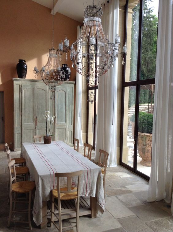 Marie Christophe chandeliers bring a double bouquet of beauty to the home of Frederic Fekkai in the south of France. #solarium #provence #countryhouse #bastide #luxury #reclaimedstone #antiques
