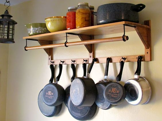 Hanging Pots And Pans On Wall upcycle a hat rack into a pot rack to hang pots in the kitchen