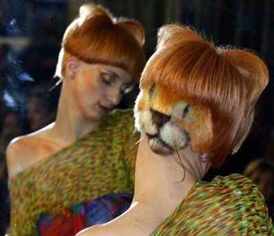woe....  Google Image Result for http://fashionisstupid.files.wordpress.com/2010/08/crazy_cat_lady.jpg