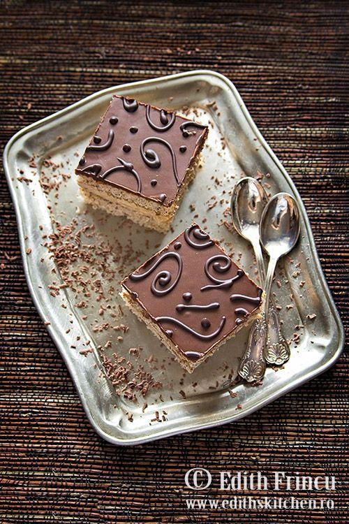 Prajitura cu ness si ciocolata - un blat pufos cu nuca, umplut cu crema delicioasa de unt cu ness, acoperita de glazura de ciocolata