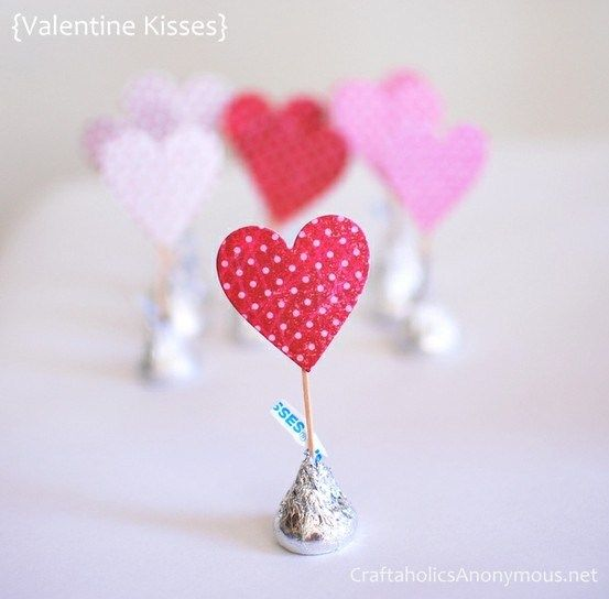 Another simple idea: select stickers or clip art for your party holiday or them, glue on toothpick, stick in a Choc Kiss. How easy would that be?