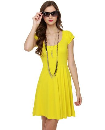 It's time to relax! Let down your hair and slip into the Wild and Free Bright Yellow Dress for some chic R! Soft yellow jersey knit wraps across cute short sleeves, cinching in at waist and flaring out at softly flowing skirt. Criss-cross panels at back reveal a sexy triangular cutout.