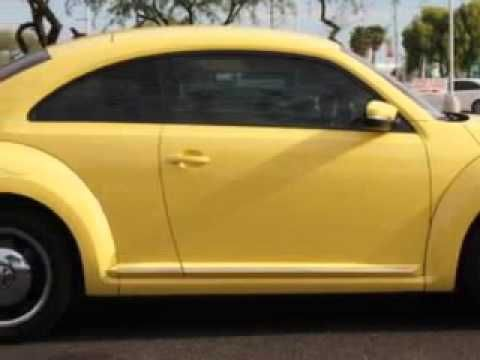 2012 Volkswagen Beetle, Lunde's Peoria Volkswagen- http://www.peoriavw.com/ check out this Saturn Yellow 2012 Volkswagen Beetle, equipped with a 5 Cyl. engine  and an automatic transmission with  19,926 miles. enjoy an impressive 29 miles to the gallon on this great car with features like leatherette upholstery, heated driver and passenger seati...