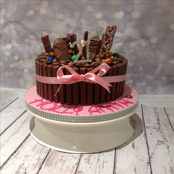 Chocolate explosion cake with curly wurly and kit-Kat edging