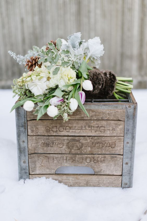 boho chic bridal bouquet wrapped in fur.