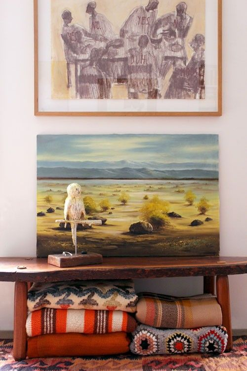 Wall art, a small statue & cozy throws