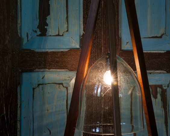 Custom designed floor lamp, made with recycled wood and glass.