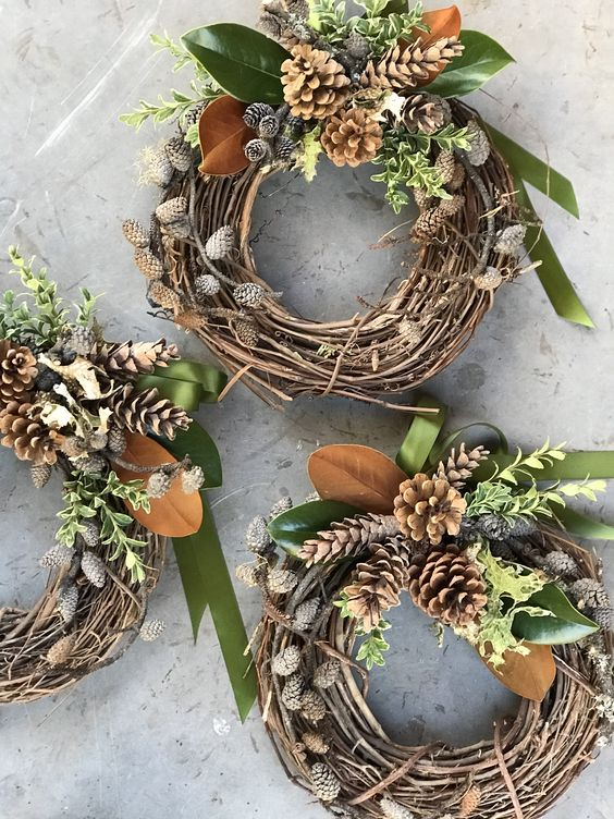 Long lasting winter wreaths embellished with pineconres, lichen, magnolia leaves and oregonia.