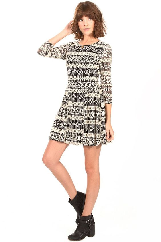 Barefoot Desert Dress   Haute Attitude   Black and cream lace skater dress with a 3/4 sleeve length. Finish off the look with knee high socks, boots, and a beanie for the colder weather. #fashion #shopping #clothing #womenswear #dresses