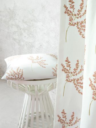 Fibre Naturelle -  Botanics Fabric Collection - Small white table with a white, pink-orange and green tree print cushion and matching floor-length curtains