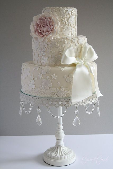 white weding cake simple ...Very pretty. Reminds me of old lace. :)