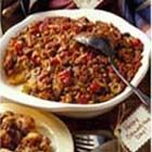 Lean Picadillo Pie - Picadillo is a Mexican minced meat filling, usually featuring olives and raisins, used for stuffing chiles, tamales and such. Here this inspired filling is the basis for a baked cornmeal-crusted oven pie.