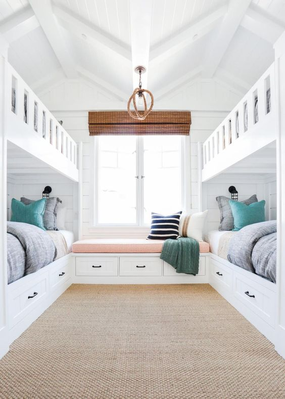 The homeowners wanted a fun retreat to house all their grandkids, and four built-in bunk beds proved the perfect solution. The kids' bedroom expertly incorporates the home's beach location into its design, so the space is just as beautiful as it is functional.:
