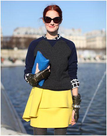 Sweatshirt style sweater over printed shirt and bright skirt.
