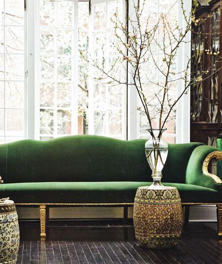Green velvet camel back sofa with gold gilt frame and gold accessories COTM Color of the Month