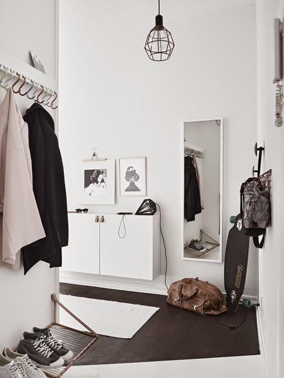 "Here at Apartment Therapy, we're huge proponents of the landing strip—having a dedicated ""clutter filter"" in the entryway can make your whole home more organized. What's more, no home is too small for this crucial bit of design know-how. Read on for my recipe for an organized foyer at any size."