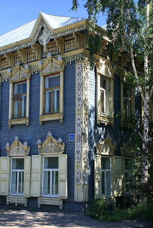 ♥ the fancy woodwork against the blue house~