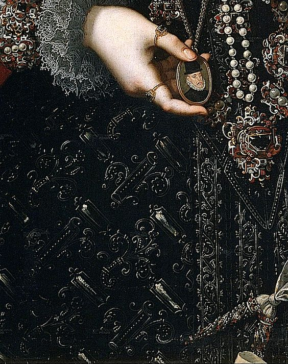 Infanta Isabella Clara Eugenia: The design on the material looks three-dimensional. The bottom jewel of her girdle has been given a triangular shape to suit the location. The skirt does not appear to be slashed in this detail, although it appears slashed looking at the over-all image.