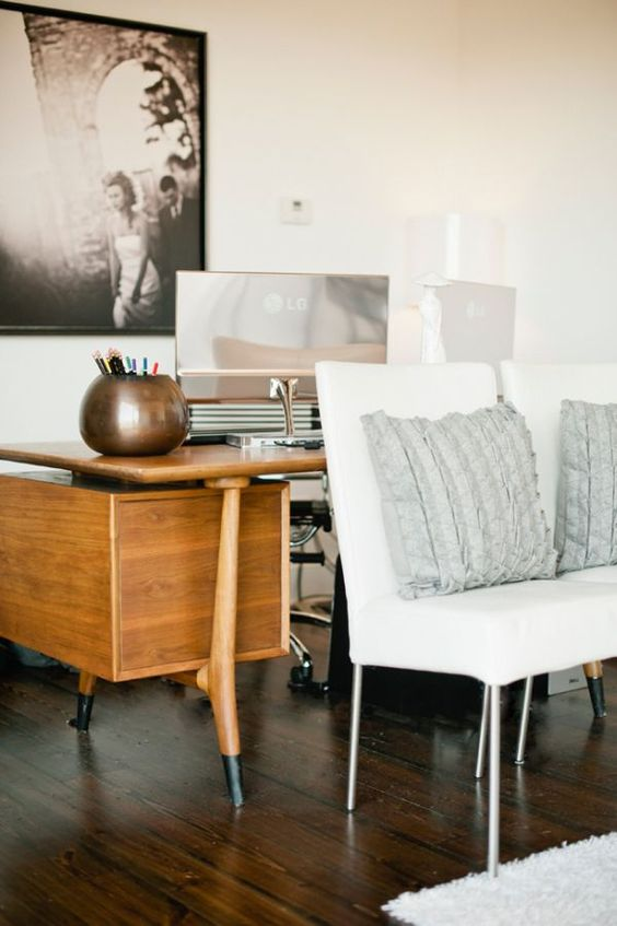 wood desk + white couch + black & white photo + ruffled pillow // Jeremy…