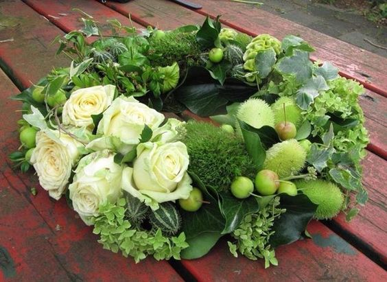 Green and white wreath.  We can add some blush roses