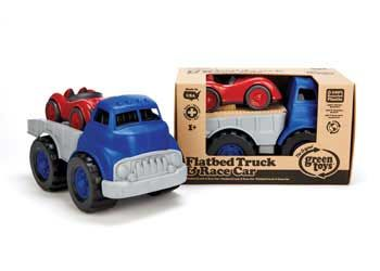 This sturdy, blue truck has a flat bed, which can be tilted to allow the red race car to drive up onto the truck. The truck measure 30cm long, and is made from ...