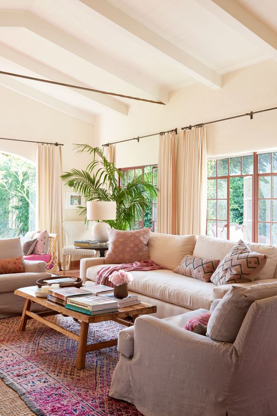 "Reese Witherspoon's House in ""Home Again"" Movie. A pretty living room with California happy chic, linen furniture, and pops of pink. It's actually the living room in the Spanish hacienda of Reese Witherspoon's House in HOME AGAIN. #livingroom #california #reesewitherspoon #homeagain"