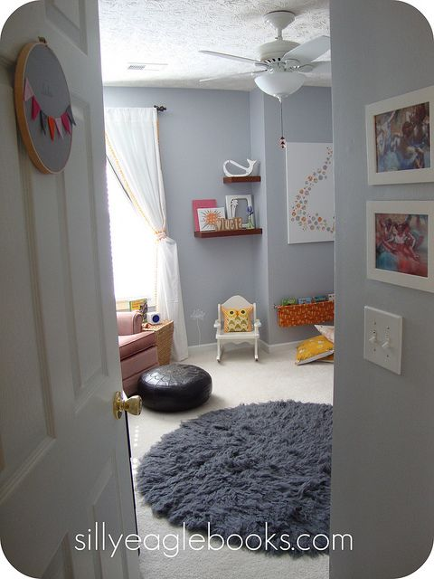 Yellow owl accent in grey room