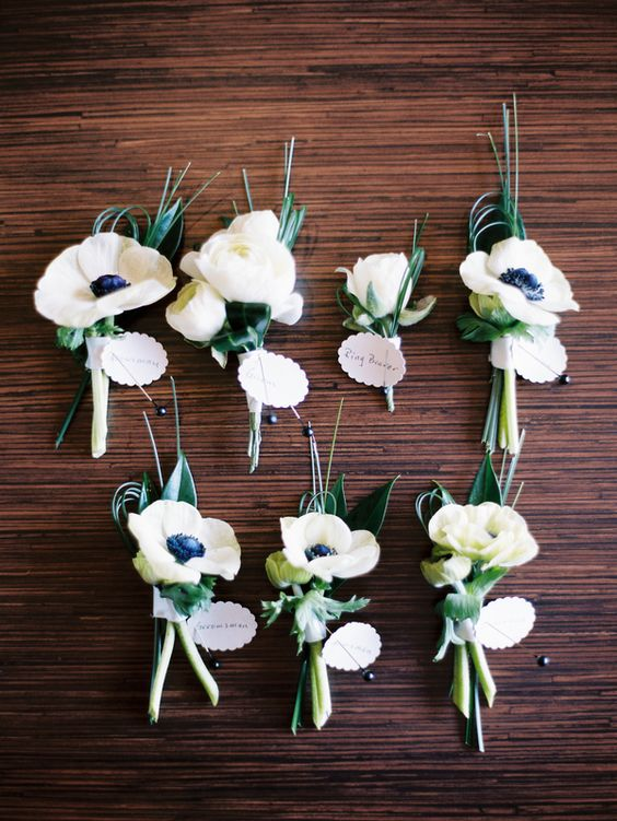 Anemones (flower) white and navy boutonnieres (with orange or navy ribbon) // photo by Mastin Studio