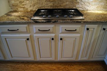 Stone backsplash off white cabinets and black on pinterest - Off white cabinets with chocolate glaze ...