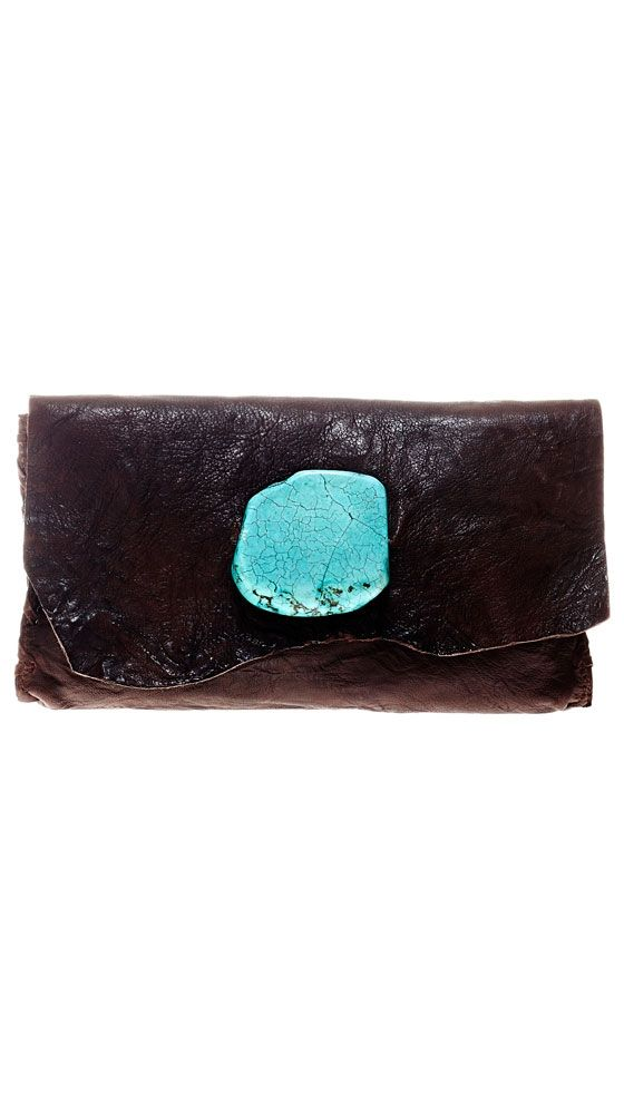 the turquoise feeds life to this worn-out-looking clutch