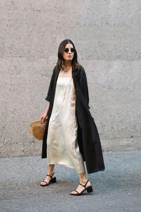 A slip dress with a long black duster and a block heel.
