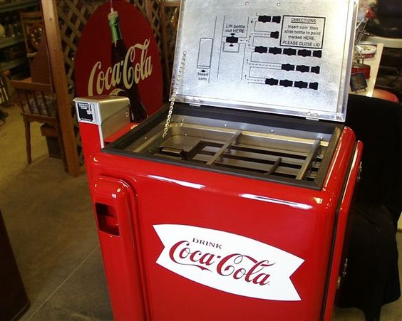 I used to love taking road trips as a kid and getting to buy an icy cold bottle of pop at gas stations from one of these. They were filled with ice cold water that was so cold your hand hurt after you snaked your selection through the dispenser, but it was well worth it!