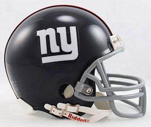 """Riddell New York Giants 1961-74 Replica Throwback Mini Helmet by Riddell. $27.99. The original, with VSR4 style shell, Z2B (running back / quarterback) facemask, interior padding, and a 4 pt. chinstrap. Official shell colors and decals. The most popular collectible helmet in history. The cornerstone of collections everywhere. The ideal autograph helmet. Approx. 5"""" tall.ÿ"""