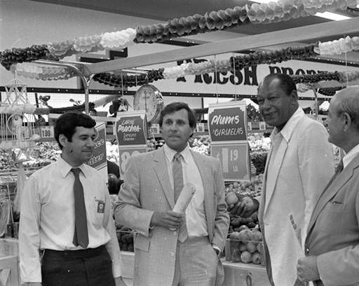 Following the ribbon cutting ceremony, Mayor Tom Bradley visits Boys Market on a tour of Pacoima Plaza, 1985. Pictured (l-r): Sam Baca (store manager), Pete Sodini (President of Boys Market, Inc.), Mayor Tom Bradley, Herbert Piken (plaza developer). Robert and Betty Franklin Collection. San Fernando Valley History Digital Library.: Sodini President, U.S. Presidents, Digital Collections