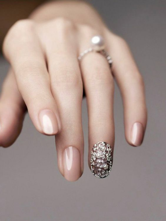 Crystal Filigree: This one is a real showstopper. It's called a nail cocoon, and done right it can be an decadent finger accessory perfect for a more ornate wedding. Just don't go too crazy with it so you don't distract from that ring! 30 Best Bridal Nail Art Designs That Will Trend This Year!   Function Mania   bridal nail polish, wedding nail art, Indian bridal nail art designs, gorgeous wedding nail art designs, wedding nails with glitter, bridal themed nail art, bridal nails, copper glitter nail art #bridalnailart #latestbridalnailartideas #bridalnailart  