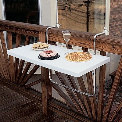 A hanging, folding balcony table like this would be a good way to have a small balcony table when I need one, without taking any valuable floor area. A solid surface like this will cast shade, so a plexiglass or metal mesh surface would be better.
