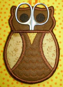 Owl Scissor Holder - This looks like something my mom would have in her craft room.