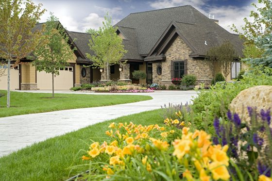 Stone work circular driveway and craftsman style homes on for L shaped craftsman home plans