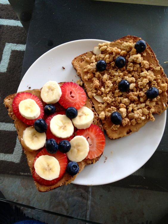 DELICIOUS! PB, honey, granola, strawberries, blueberries, bananas all in a sandwich on whole grain bread