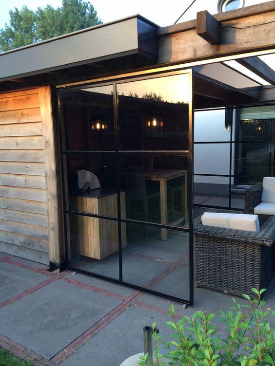 Democo stalen schuifdeur onder een veranda stalendeuren staal deur tuin veranda steel - Schuifdeur deur ...