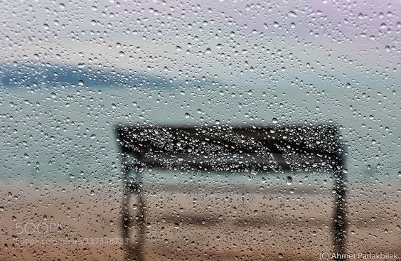 A bank by the Bosphorus under rain by ahmetp