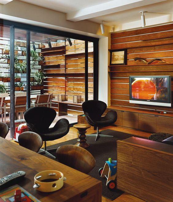 The Zizmors extended their living room by installing an 8-by-15-foot sliding glass door, which leads to an outdoor dining area built six feet above the alley. To make the outdoors feel like it's part of the living room, and not a separate patio, they ran the same horizontal pattern of ipe wood slats from the indoors out.  Photo by Roland Bello.