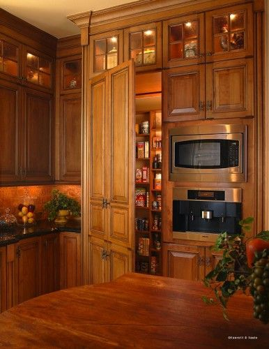 Make the pantry door look like cabinets dream house for Hidden pantry doors